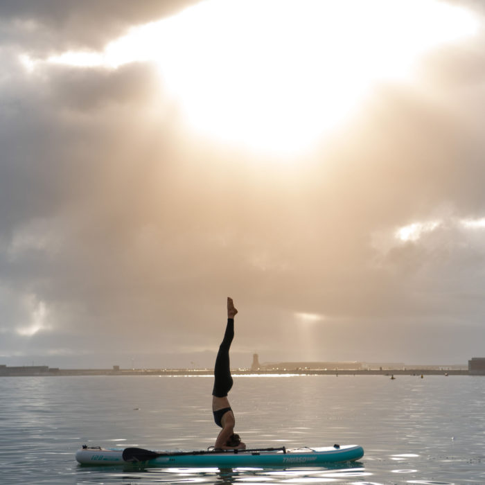 thurso surf tranquility paddle board lifestyle headstand