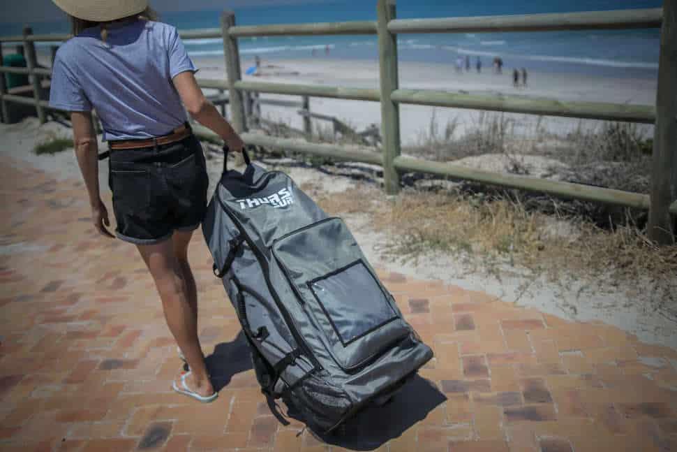 Board bag with wheels at beach