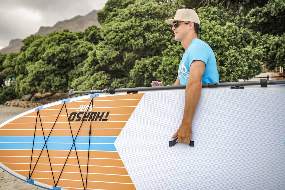 Carrying the Max board to the water