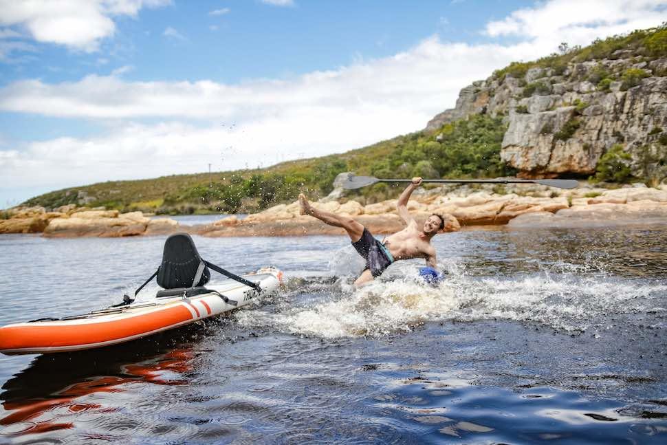 Man falling off Thurso Surf Waterwalker paddleboard