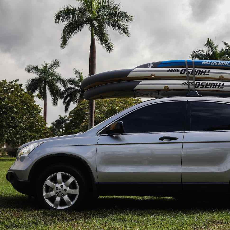Thurso Surf Waterwalker All-around SUP and Prodigy Junior SUP on roof rack