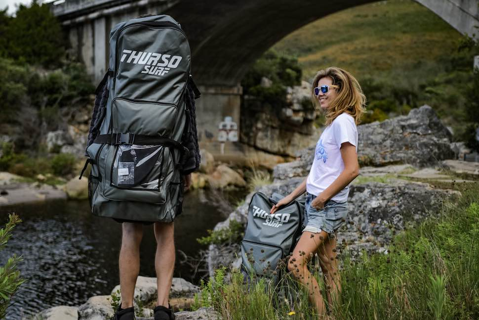 Man and woman with Thurso Surf Roller backpack