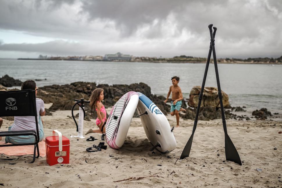 Kids play on beach near Thurso Surf Prodigy Junior SUP