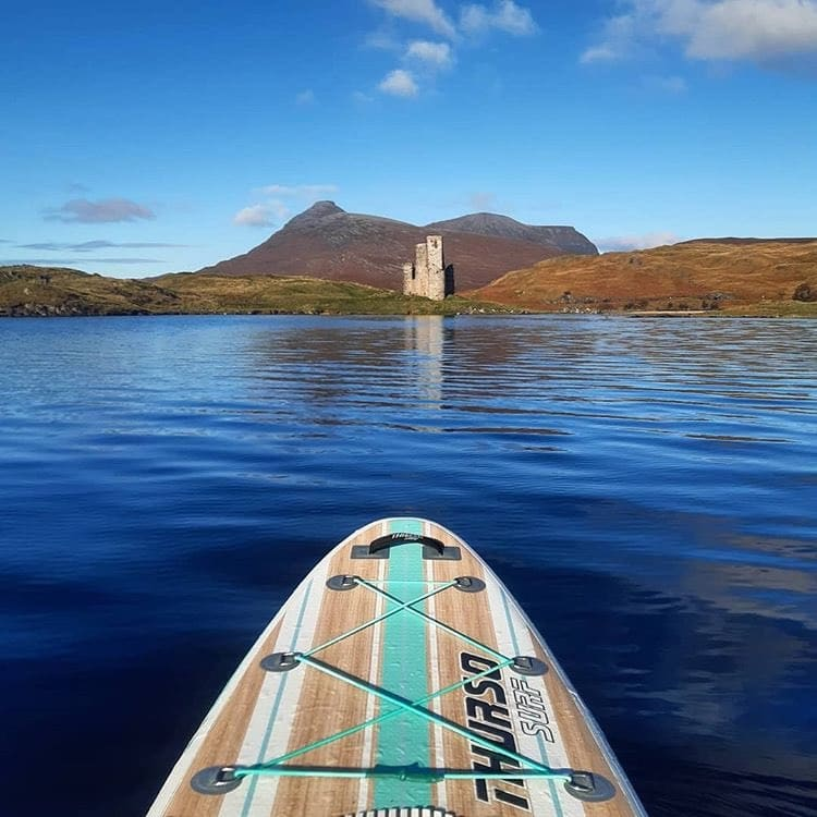 stand up paddleboarding on a loch in Scotland on a Thurso Surf Waterwalker All-Around iSUP