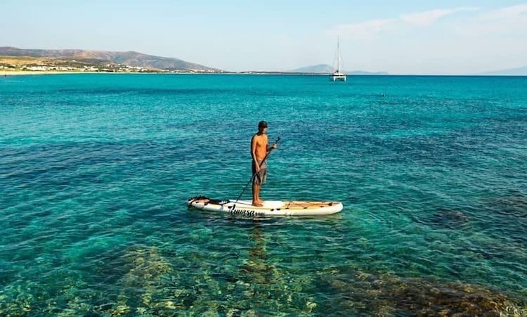 Man paddles Thurso Surf Waterwalker All-Around SUP in blue waters of Greece
