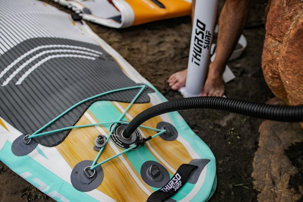 Man pumps up Thurso Surf Waterwalker All-around SUP
