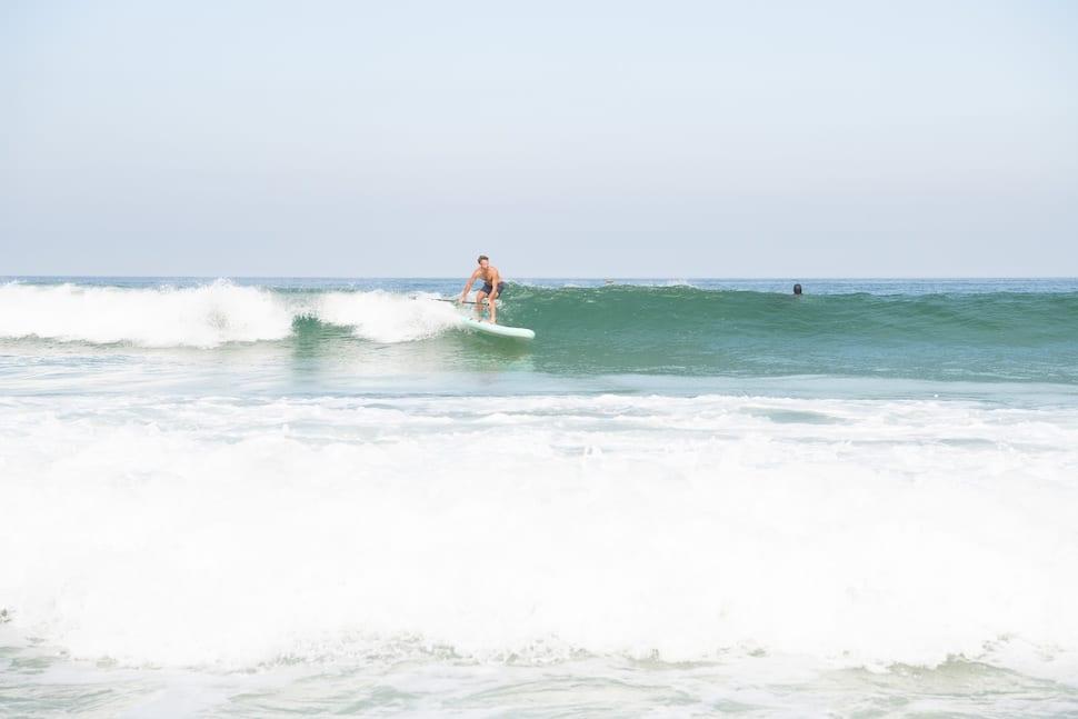 Man on Thurso Surf Waterwalker All-around SUP surfs a wave