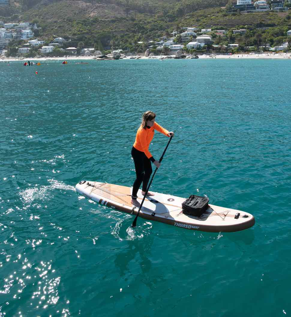 Woman paddles her Thurso Surf Waterwalker All-around paddleboard for her SUP exercise