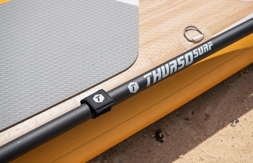 Close up of Thurso Surf paddle attached to award winning Waterwalker All-around SUP